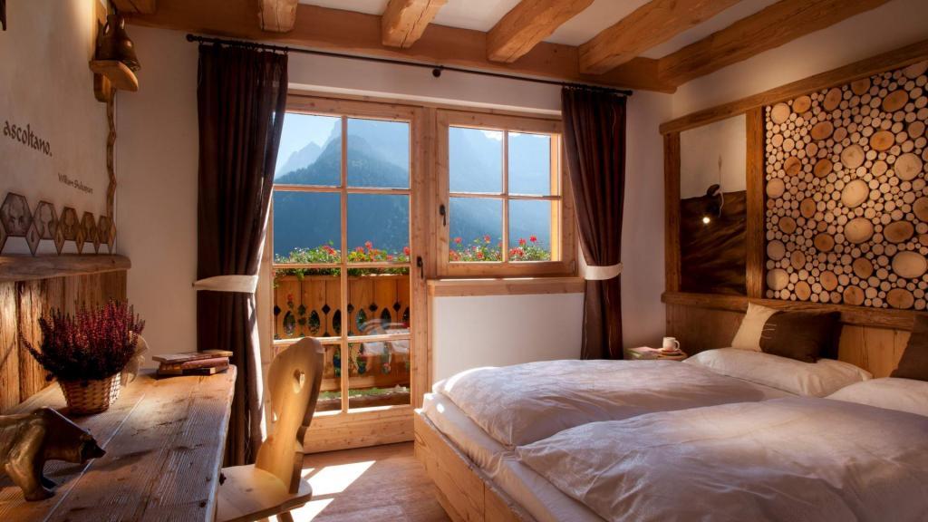Camera Terra vista Dolomiti Chalet Fogajard